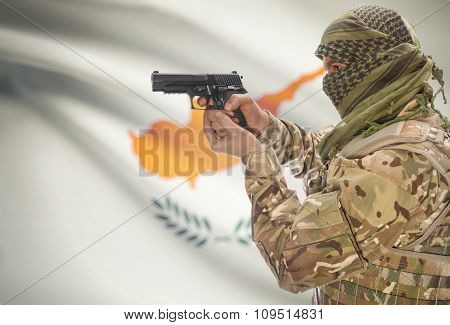 Male In Muslim Keffiyeh With Gun In Hand And National Flag On Background - Cyprus