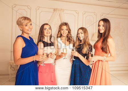 Attractive Cute Girls Celebrate A Bachelorette Party Of Bride With Champagne