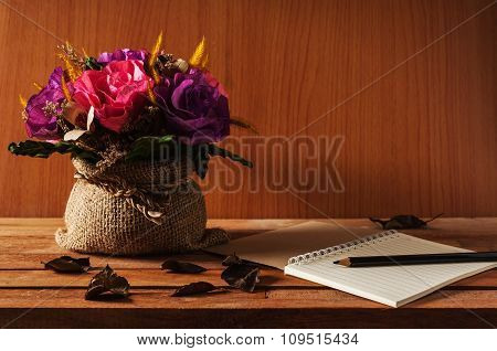 Table Of Writer, Notepad With Pencil And Flower On Wooden Table Warm Tone