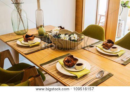 dinner on table in dining room of villa