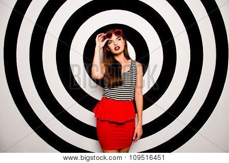 Glamorous Young Woman Holding Glasses Against The Background Of Circles