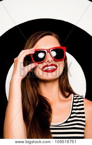 Glamorous Cheerful Girl Holding Glasses Against The Background Of Circles
