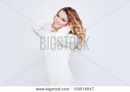 Woman in warm sweater, portrait on  white background
