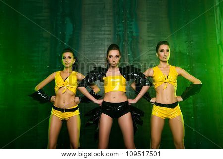 Three Sexy Confident Cute Girls In Stage Costumes