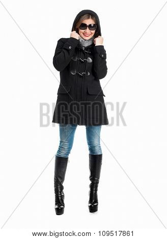 pretty girl in black coat with arms folded isolated on white background
