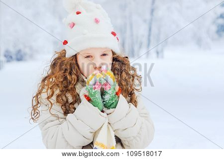 Little Girl Warms The Hands Of Breath In Winter Park.