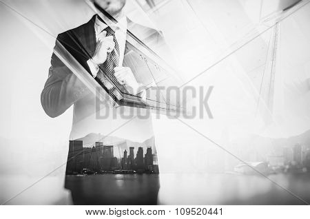 Close-up portrait of businessman straightens his own tie. Double exposure city at sunrise. Black and
