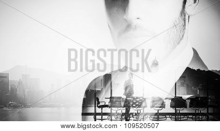 Close-up portrait of young businessman, meeting room on the background. Black and White