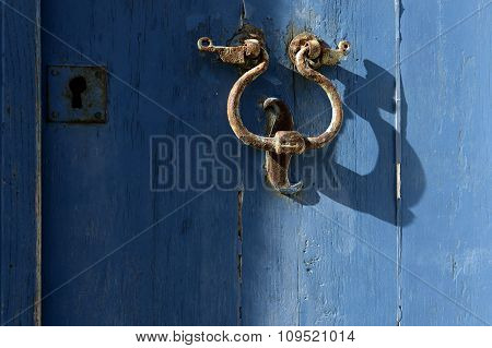 The Old Door Knocker On The Blue.