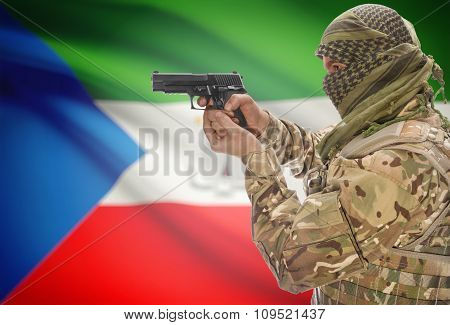 Male In Muslim Keffiyeh With Gun In Hand And National Flag On Background - Equatorial Guinea