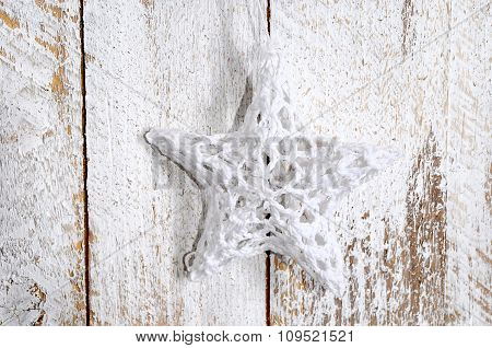 Handmade Christmas Decoration. Toy Star On Wooden Background.
