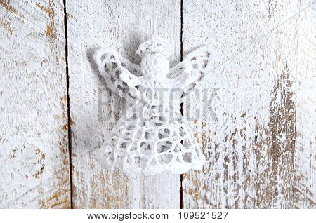 Handmade Christmas Decoration. Toy Angel On Wooden Background.