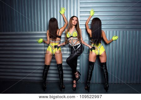 Three Confident Sexy Girls In Stage Costumes