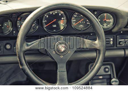 Sleza, Poland, August 15, 2015: Close Up On Porshe  Vintage Car Steering Wheel And Kockpit On  Motor