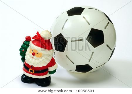 Santa Claus And The Soccer Ball On White