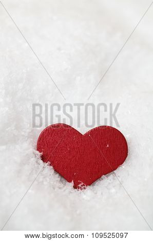 Red Heart Settled Into Snow