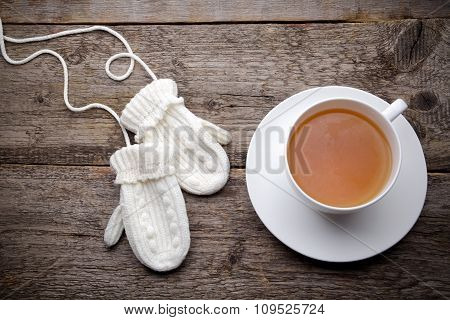 Cup of tea with gloves