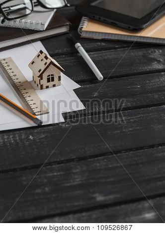 Planning Of The Construction Of A House. Office Desk With Business Objects - Open Notebook, Tablet C