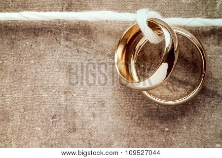 Golden Rings Hanging On Rope