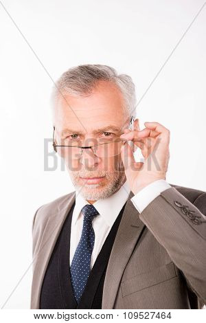 Old Businessman In An Elegant Suit With Glasses
