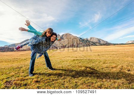 Mother Carries Daughter On Her Back  In Durmitor, Montenegro