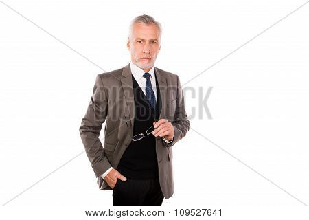 Handsome Old Businessman In An Elegant Suit On A White Background