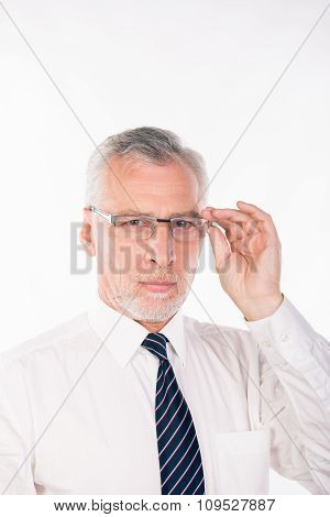 Old Businessman Holding His Glasses