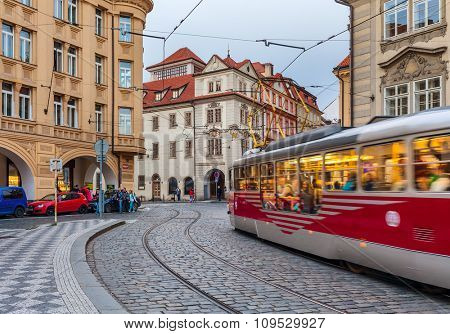 PRAGUE, CZECH REPUBLIC - SEPTEMBER 22, 2015: Tram passing in Old City of Prague. It is largest network consisting of 142 km of track, 931 trams and serves millions of passengers each year.