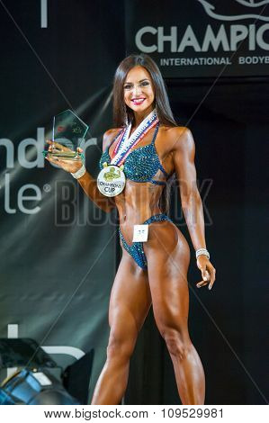 MOSCOW, RUSSIA - NOVEMBER 21, 2015: Eugenia Shestopalova participates in Bodybuilding Champions Cup during SN Pro Expo Forum 2015 on November 21, 2015 in Moscow, Russia