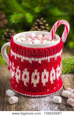 Mug With Hot Chocolate, Murshmallow And Candy Cane, Wrapped In A Winter Knitted Cup-holder