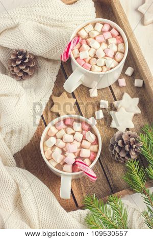 Mugs With Hot Chocolate, Murshmallow And Candy Cane On Wooden Tra