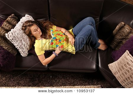 Teenager Resting On Sofa