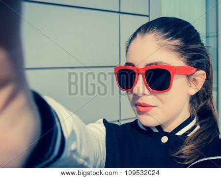 Stylish Teenage Girl In Pink Sunglasses Taking Self Portrait Outdoor