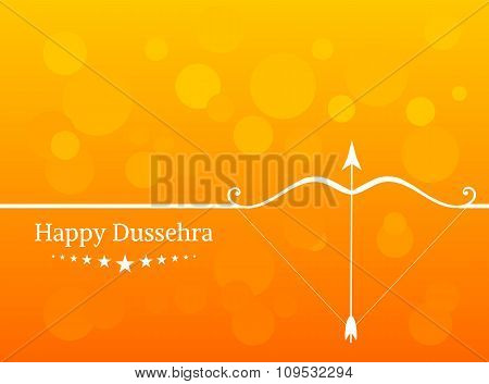 White text calligraphy inscription Happy Dussehra festival Indian with bow and colorful balls on ora