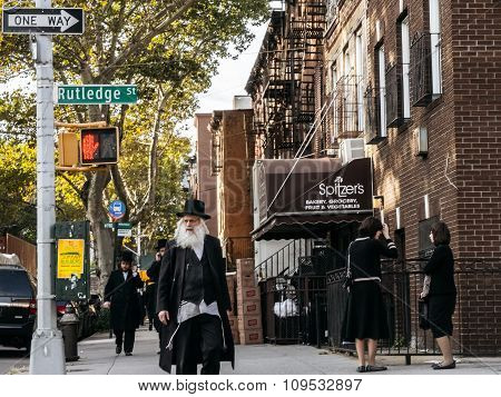 Jewish Hassidic Man Crosses The Street.