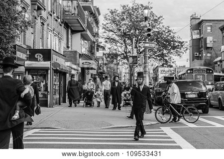 Jewish Hassidic Men Cross The Street.