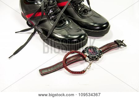 Black men shoes with red stripe, watch and bracelet
