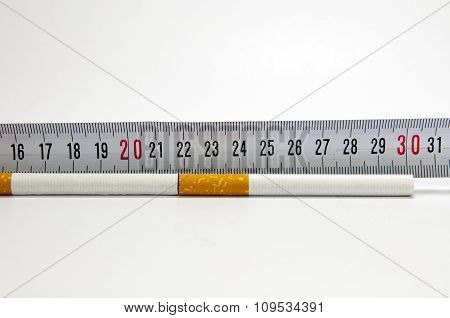 Smoking concept with measuring tape and cigarette