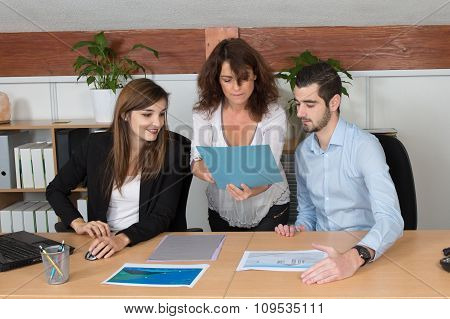 Pregnant Businesswoman Presenting Her Ideas In The Office