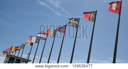 Row Of European Flags Against Blue Sky