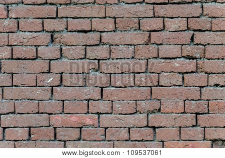 Background for design from fence of hand-made brick