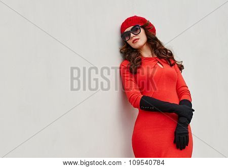 Elegant young woman portrait about the wall