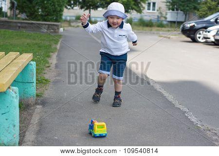 Boy With Car On The Street