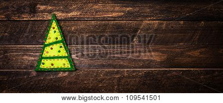 Christmas Tree On A Wooden Background With Copy-space. New Year Background With Christmas Toy Made O