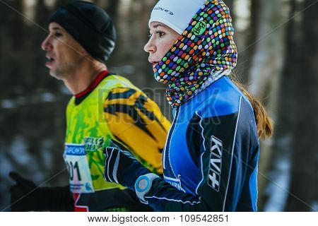 closeup face beautiful girl athletes running through Park in winter