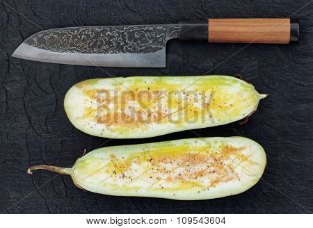 Eggplant prepared for grilling and handmade knife