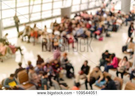 Abstract Blurred Image Of Passenger In The Airport Waiting At The Gate