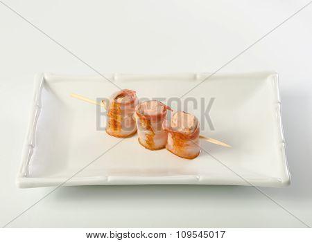 Parma ham prosciutto on stick