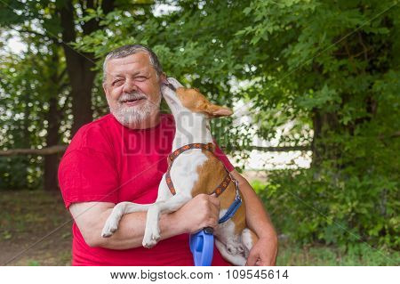 Senior man is happy when his pet shows affection