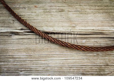 Abstract iron cable on wood